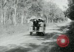 Image of Vietnamese people leaving a damaged Viet Cong camp Vietnam, 1965, second 31 stock footage video 65675032689