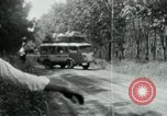 Image of Vietnamese people leaving a damaged Viet Cong camp Vietnam, 1965, second 32 stock footage video 65675032689