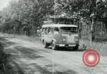 Image of Vietnamese people leaving a damaged Viet Cong camp Vietnam, 1965, second 37 stock footage video 65675032689
