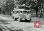 Image of Vietnamese people leaving a damaged Viet Cong camp Vietnam, 1965, second 38 stock footage video 65675032689