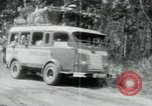 Image of Vietnamese people leaving a damaged Viet Cong camp Vietnam, 1965, second 40 stock footage video 65675032689