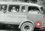 Image of Vietnamese people leaving a damaged Viet Cong camp Vietnam, 1965, second 43 stock footage video 65675032689