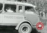 Image of Vietnamese people leaving a damaged Viet Cong camp Vietnam, 1965, second 44 stock footage video 65675032689