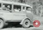 Image of Vietnamese people leaving a damaged Viet Cong camp Vietnam, 1965, second 45 stock footage video 65675032689