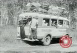 Image of Vietnamese people leaving a damaged Viet Cong camp Vietnam, 1965, second 47 stock footage video 65675032689