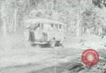 Image of Vietnamese people leaving a damaged Viet Cong camp Vietnam, 1965, second 49 stock footage video 65675032689