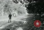 Image of Vietnamese people leaving a damaged Viet Cong camp Vietnam, 1965, second 50 stock footage video 65675032689