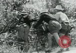 Image of Viet Cong moving supplies in Jungles on bicycles Vietnam, 1967, second 19 stock footage video 65675032692