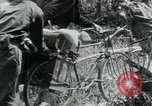 Image of Viet Cong moving supplies in Jungles on bicycles Vietnam, 1967, second 39 stock footage video 65675032692