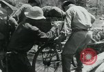 Image of Viet Cong moving supplies in Jungles on bicycles Vietnam, 1967, second 51 stock footage video 65675032692