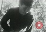 Image of Viet Cong in camp writing letters, digging bunkers, and cleaning weapo Vietnam, 1965, second 33 stock footage video 65675032694