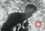 Image of Viet Cong in camp writing letters, digging bunkers, and cleaning weapo Vietnam, 1965, second 37 stock footage video 65675032694