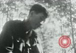 Image of Viet Cong in camp writing letters, digging bunkers, and cleaning weapo Vietnam, 1965, second 38 stock footage video 65675032694