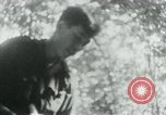 Image of Viet Cong in camp writing letters, digging bunkers, and cleaning weapo Vietnam, 1965, second 39 stock footage video 65675032694