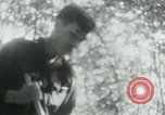 Image of Viet Cong in camp writing letters, digging bunkers, and cleaning weapo Vietnam, 1965, second 40 stock footage video 65675032694