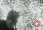 Image of Viet Cong in camp writing letters, digging bunkers, and cleaning weapo Vietnam, 1965, second 43 stock footage video 65675032694