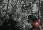 Image of Vietnamese families carrying food and supplies into Viet Cong camp in  Vietnam, 1965, second 6 stock footage video 65675032697