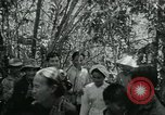 Image of Vietnamese families carrying food and supplies into Viet Cong camp in  Vietnam, 1965, second 9 stock footage video 65675032697