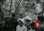Image of Vietnamese families carrying food and supplies into Viet Cong camp in  Vietnam, 1965, second 10 stock footage video 65675032697