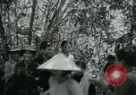 Image of Vietnamese families carrying food and supplies into Viet Cong camp in  Vietnam, 1965, second 12 stock footage video 65675032697