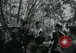 Image of Vietnamese families carrying food and supplies into Viet Cong camp in  Vietnam, 1965, second 14 stock footage video 65675032697
