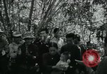 Image of Vietnamese families carrying food and supplies into Viet Cong camp in  Vietnam, 1965, second 15 stock footage video 65675032697