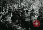 Image of Vietnamese families carrying food and supplies into Viet Cong camp in  Vietnam, 1965, second 23 stock footage video 65675032697