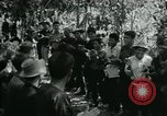 Image of Vietnamese families carrying food and supplies into Viet Cong camp in  Vietnam, 1965, second 25 stock footage video 65675032697