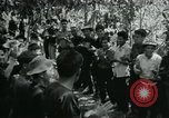 Image of Vietnamese families carrying food and supplies into Viet Cong camp in  Vietnam, 1965, second 27 stock footage video 65675032697