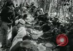 Image of Vietnamese families carrying food and supplies into Viet Cong camp in  Vietnam, 1965, second 28 stock footage video 65675032697