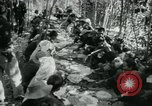 Image of Vietnamese families carrying food and supplies into Viet Cong camp in  Vietnam, 1965, second 29 stock footage video 65675032697