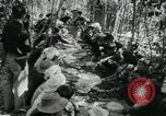 Image of Vietnamese families carrying food and supplies into Viet Cong camp in  Vietnam, 1965, second 31 stock footage video 65675032697