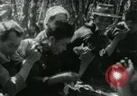 Image of Vietnamese families carrying food and supplies into Viet Cong camp in  Vietnam, 1965, second 34 stock footage video 65675032697