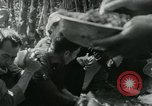 Image of Vietnamese families carrying food and supplies into Viet Cong camp in  Vietnam, 1965, second 35 stock footage video 65675032697