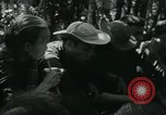 Image of Vietnamese families carrying food and supplies into Viet Cong camp in  Vietnam, 1965, second 36 stock footage video 65675032697