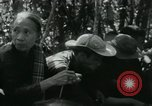 Image of Vietnamese families carrying food and supplies into Viet Cong camp in  Vietnam, 1965, second 39 stock footage video 65675032697