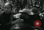 Image of Vietnamese families carrying food and supplies into Viet Cong camp in  Vietnam, 1965, second 40 stock footage video 65675032697