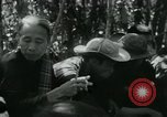 Image of Vietnamese families carrying food and supplies into Viet Cong camp in  Vietnam, 1965, second 41 stock footage video 65675032697