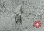 Image of Vietnamese families carrying food and supplies into Viet Cong camp in  Vietnam, 1965, second 51 stock footage video 65675032697