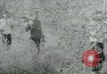 Image of Vietnamese families carrying food and supplies into Viet Cong camp in  Vietnam, 1965, second 58 stock footage video 65675032697