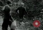 Image of Vietnamese families carrying food and supplies into Viet Cong camp in  Vietnam, 1965, second 59 stock footage video 65675032697