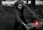 Image of People cleaning up a lot for use as a playground Monroe New York USA, 1950, second 2 stock footage video 65675032772
