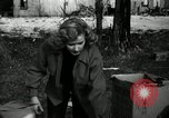Image of People cleaning up a lot for use as a playground Monroe New York USA, 1950, second 3 stock footage video 65675032772