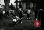Image of People cleaning up a lot for use as a playground Monroe New York USA, 1950, second 14 stock footage video 65675032772