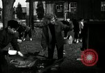 Image of People cleaning up a lot for use as a playground Monroe New York USA, 1950, second 23 stock footage video 65675032772