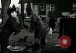 Image of People cleaning up a lot for use as a playground Monroe New York USA, 1950, second 24 stock footage video 65675032772