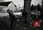 Image of People cleaning up a lot for use as a playground Monroe New York USA, 1950, second 28 stock footage video 65675032772