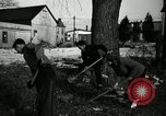 Image of People cleaning up a lot for use as a playground Monroe New York USA, 1950, second 29 stock footage video 65675032772