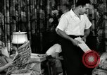 Image of auto worker Detroit Michigan USA, 1950, second 16 stock footage video 65675032773