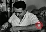 Image of auto worker Detroit Michigan USA, 1950, second 32 stock footage video 65675032773